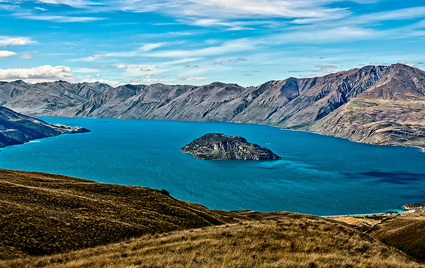 View of a section of Lake Wanaka containing the island of Mou Waho, near the town of Wanaka on the South Island of New Zealand.