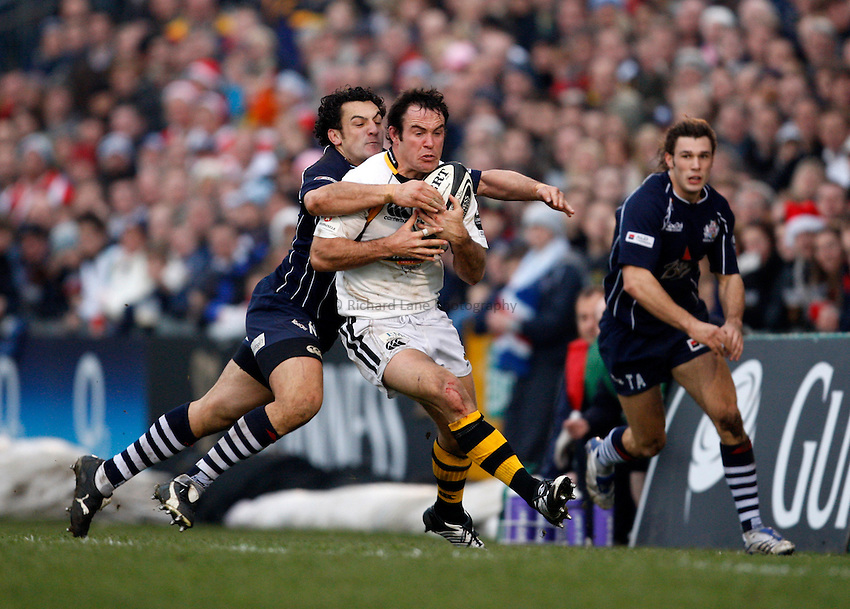 Photo: Richard Lane/Richard Lane Photography..Bristol Rugby v London Wasps. Guinness Premiership. 22/12/2007. .Wasps' Fraser Waters is tackled by Bristol's Neil Brew.