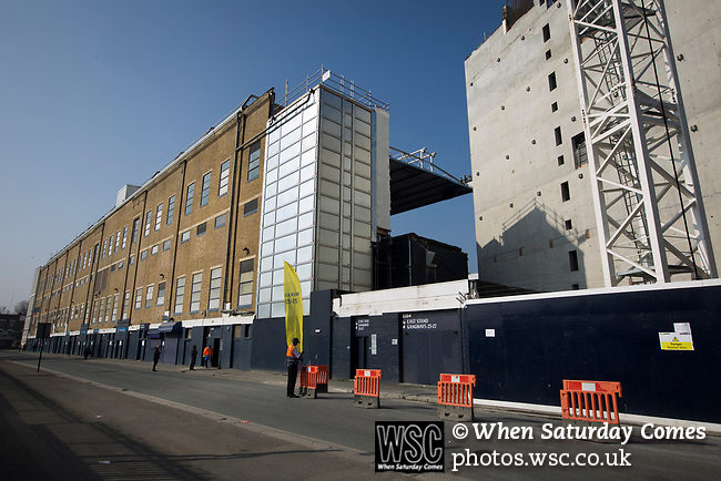 Tottenham Hotspur 4 Watford 0, 08/04/2017. White Hart Lane, Premier League. A steward on duty outside the East Stand on Worcester Avenue before Tottenham Hotspur took on Watford in an English Premier League match at White Hart Lane. Spurs were due to make an announcement in April 2016 regarding when they would move out of their historic home and relocate to Wembley as their new stadium was completed. Spurs won this match 4-0 watched by a crowd of 31,706, a reduced attendance figure due to the ongoing ground redevelopment. Photo by Colin McPherson.