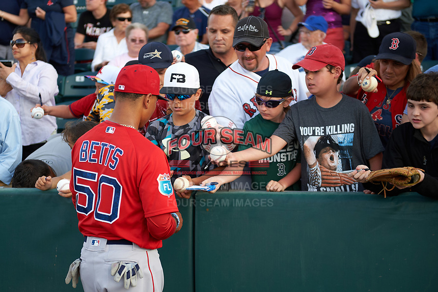 Boston Red Sox right fielder Mookie Betts (50) signs autographs before a Spring Training game against the Minnesota Twins on March 16, 2016 at Hammond Stadium in Fort Myers, Florida.  Minnesota defeated Boston 9-4.  (Mike Janes/Four Seam Images)