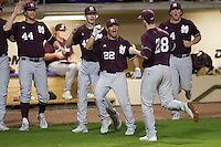Mississippi State Bulldog starting pitcher Chris Straton #28 is greeted by his teammates after striking out another LSU Tiger during the NCAA baseball game on March 16, 2012 at Alex Box Stadium in Baton Rouge, Louisiana. LSU defeated Mississippi State 3-2 in 10 innings. (Andrew Woolley / Four Seam Images)