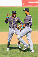 Quad Cities River Bandits outfielder Ronnie Dawson (12) and first baseman Taylor Jones (46) during a Midwest League game against the Beloit Snappers on June 18, 2017 at Pohlman Field in Beloit, Wisconsin.  Quad Cities defeated Beloit 5-3. (Brad Krause/Krause Sports Photography)