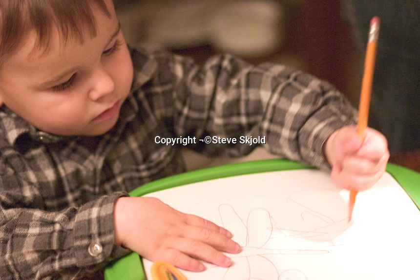 Boy age 2 drawing with Crayola Trace N Draw Projector.  Plymouth Minnesota USA