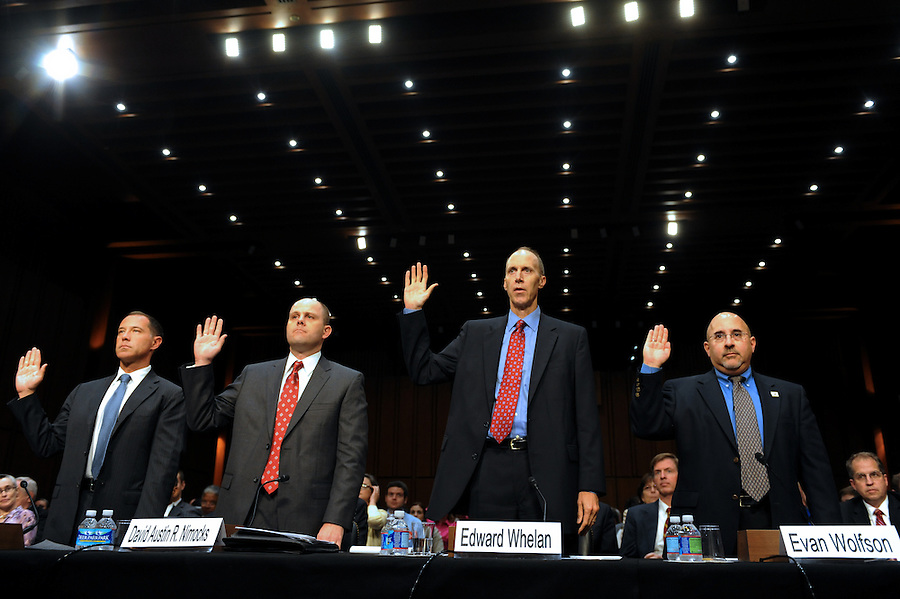 """Joe Solmonese, president of the Human Rights Campaign, David Austin R. Nimocks, senior legal counsel for the Alliance Defense Fund,  Edward Whelan, president of Ethics and Public Policy Center, and Evan Wolfson, founder and executive director at Freedom to Marry, swear in before testifying in the hearing  """"S.598, The Respect for Marriage Act: Assessing the Impact of DOMA on American Families."""" (Photos by ©Amanda Lucidon/LucidPix)"""
