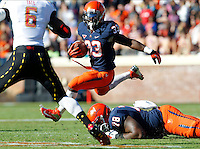 Virginia Cavaliers running back Perry Jones (33) leaps over Virginia Cavaliers offensive tackle Morgan Moses (78) in front of Maryland Terrapins linebacker Kenneth Tate (6) during the game at Scott Stadium in Charlottesville, VA. Photo/The Daily Progress/Andrew Shurtleff