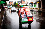 A man pushes a wheelbarrow with drinks in a street in Bogota, Colombia. 29/02/2012.  Photo by Eduardo Munoz Alvarez / VIEWpress.