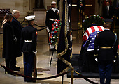 US President Donald Trump and his wife Melania Trump arrive to pay their respects to former US President George H. W. Bush as he lies in state in the US Capitol's rotunda December 3, 2018 in Washington, DC. - The body of the late former President George H.W. Bush travelled from Houston to Washington, where he will lie in state at the US Capitol through Wednesday morning. Bush, who died on November 30, will return to Houston for his funeral on Thursday. (Photo by Brendan SMIALOWSKI / AFP)