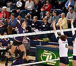 SIOUX FALLS, SD - OCTOBER 14: Emily Johnson #8 from the University of Sioux Falls winds up for a kill against Becca Finley #4 from Augustana in the second game of their match Tuesday night at the Elmen Center. (Photo by Dave Eggen/Inertia)