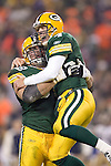 Green Bay Packers quarterback Brett Favre (4) and offensive lineman Marco Rivera (62) celebrate during an NFL football game against the St. Louis Rams in Green Bay, Wisconsin on on November 29, 2004. The Packers defeated the Rams 45-17. (Photo by David Stluka)