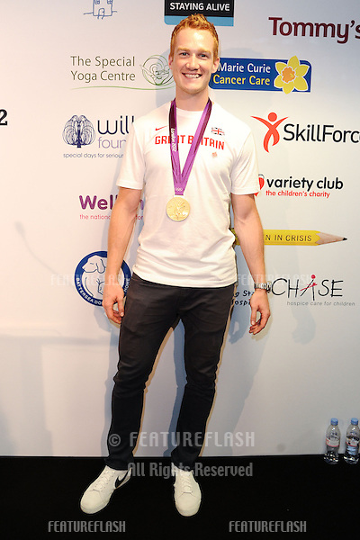 Olympic long jumper, Greg Rutherford on the trading floor of BGC as part of the BGC Charity Day 2012, Canary Wharf, London. 11/09/2012 Picture by: Steve Vas / Featureflash