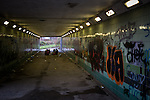 © Joel Goodman - 07973 332324 . 8 December 2013 . Youths sitting in a circle in the centre of a graffiti covered pedestrian underpass adjacent to the River Irwell , listening to music . Photo credit : Joel Goodman