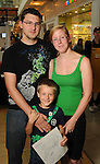 Andrea and David Holmes with their son Connor,5, at the M.D. Anderson Back-to-School Fashion Show at the Galleria Saturday Aug. 16, 2014.(Dave Rossman photo)