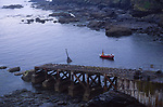 AJ02NB Fishing boat and old lifeboat launch Lizard Point Cornwall England