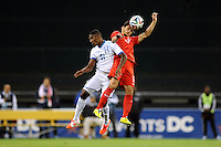 Washington, D.C.- May 29, 2014. Turkey forward Mustafa Pektemek heads the ball against Honduras  defender Brayan Beckeles.  Turkey defeated Honduras 2-0 during an international friendly game at RFK Stadium.