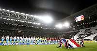 Calcio, Serie A: Juventus vs Milan. Torino, Juventus Stadium, 21 novembre 2015. <br /> Juventus and AC Milan players line up prior to the start of the Italian Serie A football match between Juventus and AC Milan at Turin's Juventus stadium, 21 November 2015. At right, children hold the French flag in homage to the victims of Paris' terrorist attacks.<br /> UPDATE IMAGES PRESS/Isabella Bonotto