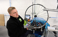 Pictured: Neal Brookfield assembling spokes with rims Monday 15 August 2016<br /> Re: Frog Bikes in Mamhilad Estate Park in Pontypool, Wales, UK