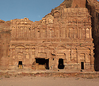 Palace tomb, one of the Royal tombs, 1st century AD, Petra, Ma'an, Jordan. These tombs were carved by the Nabateans for their Kings in the face of Jabal al-Khubtha, the mountain overlooking Petra on the East. This tomb has a 3 storey facade and sits behind a stage and large courtyard. It imitates the style of a Roman palace. Petra was the capital and royal city of the Nabateans, Arabic desert nomads. Picture by Manuel Cohen