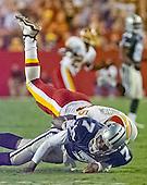 Washington Redskins linebacker LaVar Arrington (56) takes down Dallas Cowboys quarterback Randall Cunningham (7) during the game at FedEx Field on Monday, September 18, 2000.  The Cowboys won the game 27 - 21.<br /> Credit: Arnie Sachs / CNP