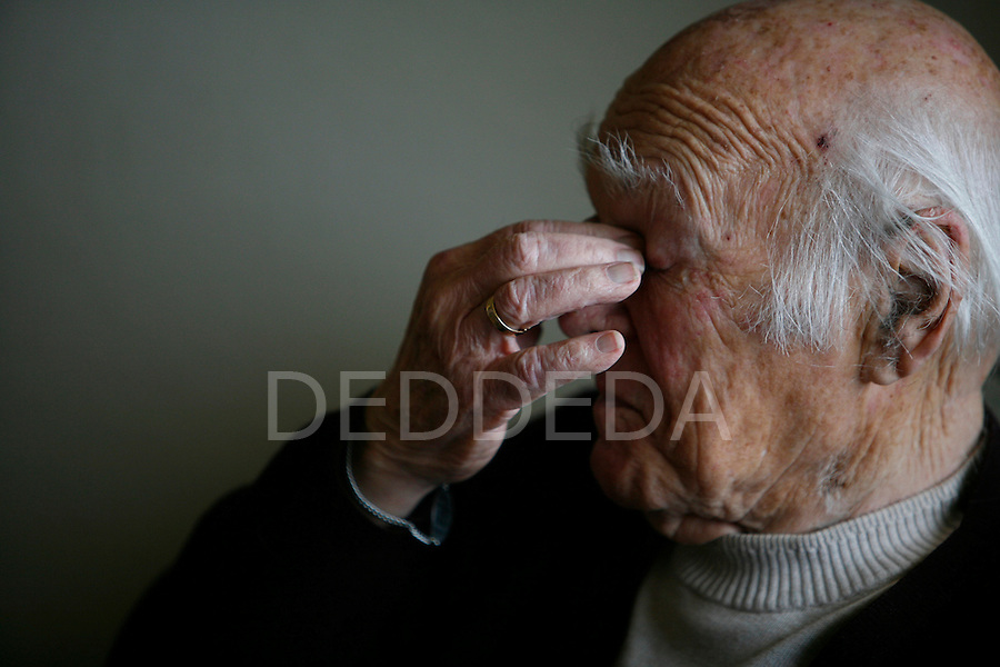 Thomas McLeod, 88, rubs his eyes as he sits in his favorite chair at his home in Victoria, BC. McLeod, who received the Order of Canada three years ago, is one of the last so-called Saskatchewan Mafia, the bureaucrats who went from serving the CCF government on the prairies to join the fevderal civil service in Ottawa. Photo assignment for the Globe and Mail national newspaper in Canada.