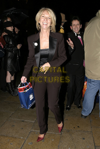 HELEN WORTH.Leaving party at The Critterion, London, .November 8th 2004..full length laughing goody bag.Ref: AH.www.capitalpictures.com.sales@capitalpictures.com.©Capital Pictures.