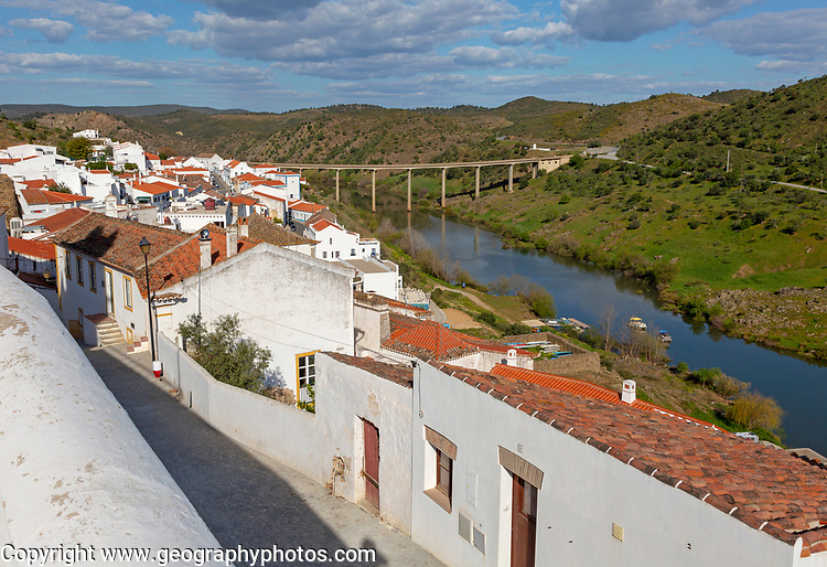 Landscape view of valley of river Rio Guadiana over rooftops in the medieval village of Mértola, Baixo Alentejo, Portugal, Southern Europe