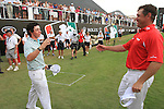 Dubai World Championship Golf. Earth Course,.Jumeirah Golf Estate, Dubai, U.A.E...Rory McIlroy heads out to congratulate Lee Westwood after sinking his putt on the 18th to clinch the title of the Dubai World Golf championship..Photo: Fran Caffrey/www.golffile.ie...