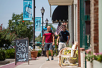 NWA Democrat-Gazette/JASON IVESTER <br /> Jarrod Benningfield (left) of Springdale and Steven McDaniel of Fayetteville walk on Friday, Aug. 14, 2015, along the sidewalk past businesses on Walnut Street in downtown Rogers.