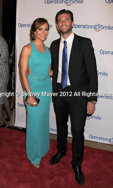 BEVERLY HILLS, CA - SEPTEMBER 28: Satcha Pretto and Aaron Butler attend Operation Smile's 30th Anniversary Smile Gala - Arrivals at The Beverly Hilton Hotel on September 28, 2012 in Beverly Hills, California.