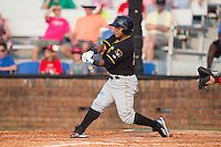 Henrry Rosario (52) of the Bristol Pirates makes contact with the baseball during the game against the Johnson City Cardinals at Howard Johnson Field at Cardinal Park on July 6, 2015 in Johnson City, Tennessee.  The Pirates defeated the Cardinals 2-0 in game one of a double-header. (Brian Westerholt/Four Seam Images)