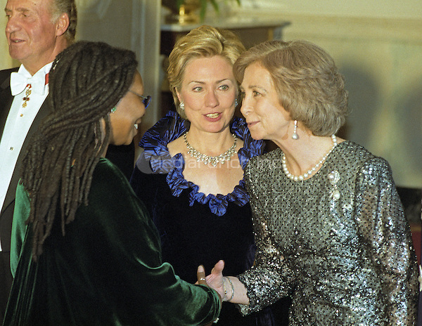 Actress Whoopi Goldberg, left, is introduced to Queen Sofia of Spain, right, by First Lady Hillary Rodham Clinton, center, as she passes through the receiving line in the Grand Foyer of the White House prior to the State Dinner honoring the Queen and King Juan Carlos I of Spain on February 23, 2000 in Washington, D.C.<br /> Credit: Ron Sachs / CNP/MediaPunch