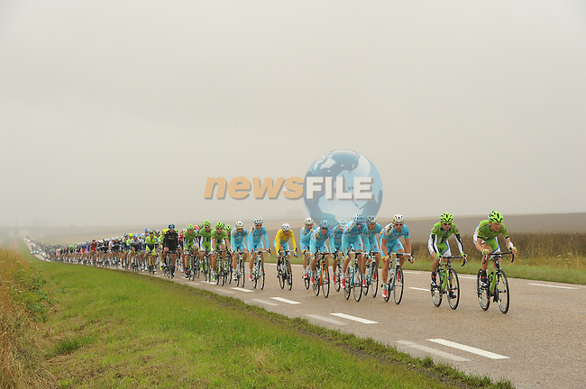 The peleton including race leader Vincenzo Nibali (ITA) and his Astana team strung out during Stage 7 of the 2014 Tour de France running 234.5km from Epernay to Nancy. 11th July 2014.<br /> Photo ASO/G.Demouveaux/www.newsfile.ie