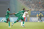 19 August 2008: Chibuzor Okonkwo (NGA) (2) has a teammate hitch a ride on his shirttails as he celebrates his second half goal.  The men's Olympic soccer team of Nigeria defeated the men's Olympic soccer team of Belgium 4-1 at Shanghai Stadium in Shanghai, China in a Semifinal match in the Men's Olympic Football competition.
