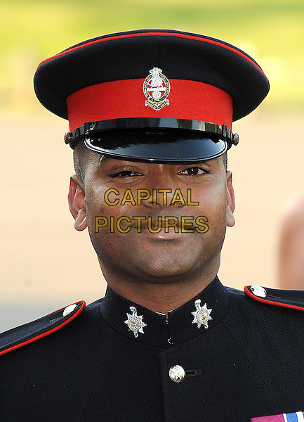 JOHN BEHARRY.at the Caudwell Children Butterfly Ball at Battersea Evolution, London, England, UK, May 20th, 2010 .portrait headshot red black cap hat uniform  military .CAP/BEL.©Tom Belcher/Capital Pictures.
