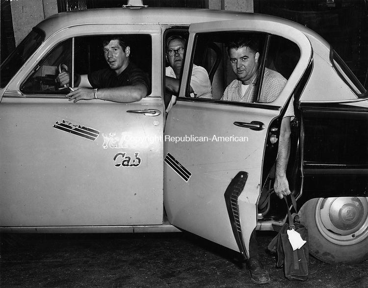 Taxis were used to take out-of-town gas servicemen to all parts of the city to aid in repairs after the flood. William Cook, cab driver, is shown starting out for one of the city's outlying areas with Eugene Butler and Fred Ricciardi, both employees of the Consolidated Edison Co. of New York City.