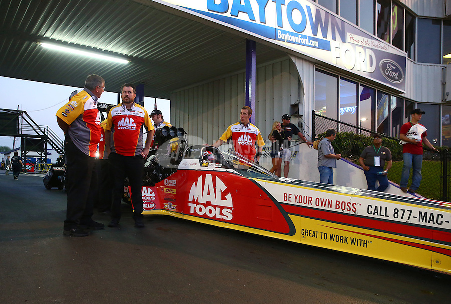 Apr 25, 2014; Baytown, TX, USA; Crew members for NHRA top fuel dragster driver Doug Kalitta during qualifying for the Spring Nationals at Royal Purple Raceway. Mandatory Credit: Mark J. Rebilas-