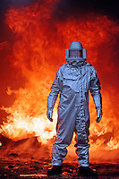 firefighter in protective aluminium suit at aircraft fire...© SHOUT. EXACT DATE OF PICTURE UNKNOWN. THIS PICTURE MUST ONLY BE USED TO ILLUSTRATE THE EMERGENCY SERVICES IN A POSITIVE MANNER. CONTACT JOHN CALLAN. john@shoutpictures.com.www.shoutpictures.com.