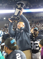 State College, PA - 11/26/2016:  Penn State head coach James Franklin raises the Big Ten East Division championship trophy after the game. #7 Penn State defeated Michigan State by a score of 45-12 to secure the Big Ten conference East Division championship on Senior Day, Saturday, November 26, 2016, at Beaver Stadium in State College, PA.<br /> <br /> Photos by Joe Rokita / JoeRokita.com