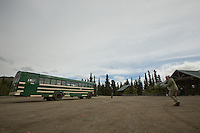 Lori walks toward the park bus at the Teklanika River rest stop in Denali National Park.