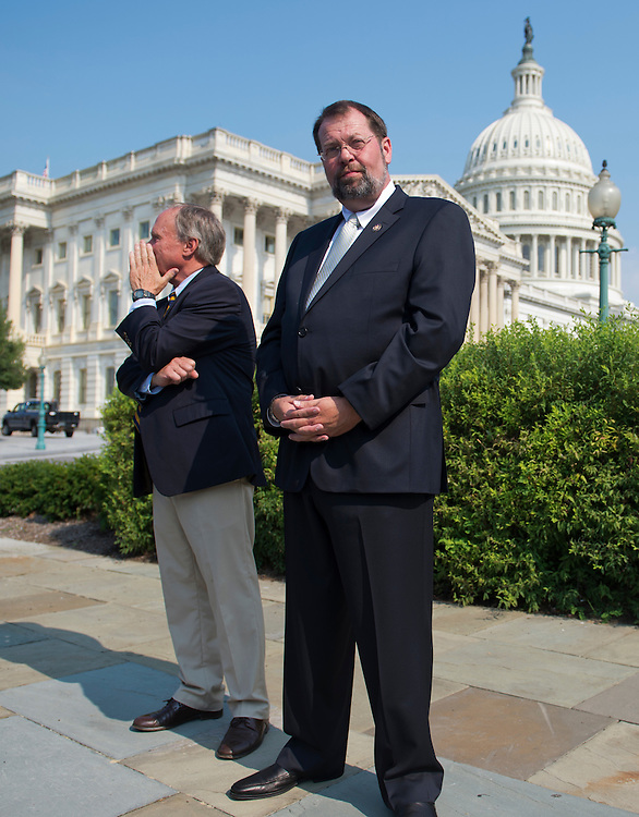"UNITED STATES - AUGUST 02:  Reps. Steve LaTourette, R-Ohio, right, and Charlie Bass, R-N.H., attend a news conference at the House Triangle to call on Congress to work together to address a possible financial crisis in the future dubbed the ""fiscal cliff.""  (Photo By Tom Williams/CQ Roll Call)"