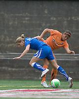 Boston Breakers forward/midfielder Kelly Smith (10) and Sky Blue FC defender Brittany Taylor (14) battle in the corner. Sky Blue FC defeated the Boston Breakers, 2-1, at Harvard Stadium on June 13, 2010.