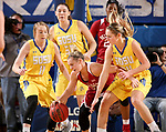 BROOKINGS, SD - DECEMBER 6: Madison Guebert #11, Megan Bultsma	 #50 and Tagyn Larson #24 from South Dakota State surround Gabbi Ortiz #21 from Oklahoma during their game Wednesday night at Frost Arena in Brookings. (Photo by Dave Eggen/Inertia)