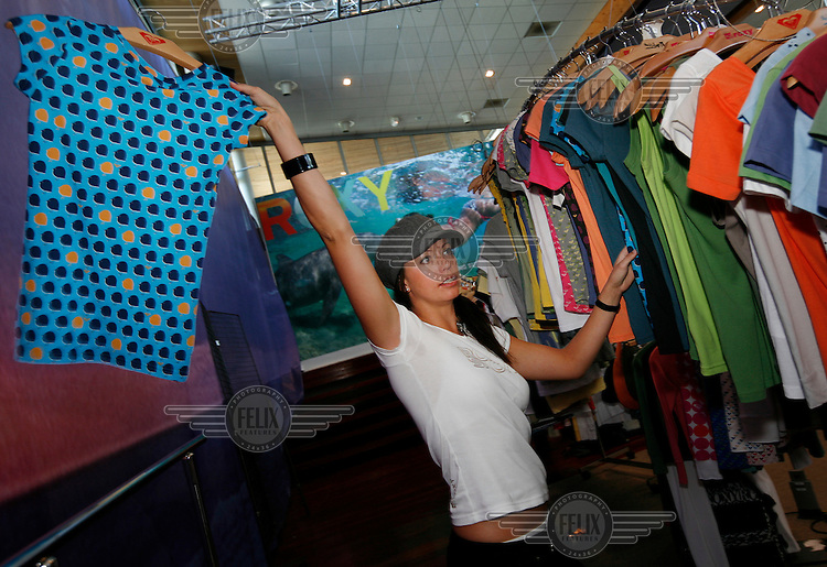 Marketing director for Roxy,  Stine Brun Kjeldaas, is a former snowboard professional and Olympic silver medalist. Here she is seen choosing outfits for a photo shoot at Roxy Europe headquarters in Saint Jean de Luz, near Biarritz, France.