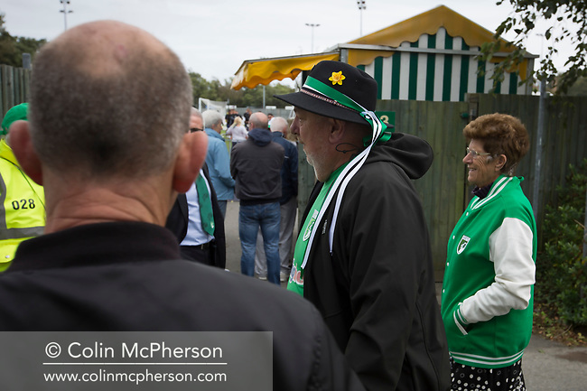 Home fans arriving at the ground as Guernsey take on Corinthian-Casuals in a Isthmian League Division One South match at Footes Lane. Formed in 2011, Guernsey FC are a community club located in St. Peter Port on the island of Guernsey and were promoted to the Isthmian League Division One South in 2013. The visitors from Kingston upon Thames won the fixture by 1-0, watched by a crowd of 614 spectators.