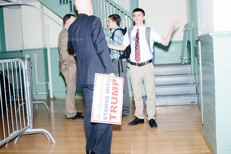 People argue over climate change after hearing real estate mogul and Republican presidential candidate Donald Trump speak at a rally at Exeter Town Hall in Exeter, New Hampshire, on Thurs., Feb. 4, 2016.