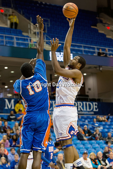 Texas-Arlington Mavericks forward Deon Rodgers (42) and Houston Baptist Huskies center Lamar Thomas (10) in action during the game between the Houston Baptist Huskies and the Texas-Arlington Mavericks at the College Park Center arena in Arlington, Texas. UTA defeats Houston Baptist 81 to 47...