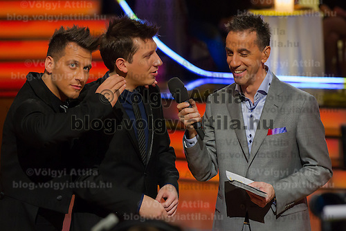 """Csaba Vastag (L), Tamas Vastag (C) and Andras Csonka """"Pici"""" talk during the the live broadcast celebrity dancing talent show Saturday Night Fever by Hungarian television company RTL II in Budapest, Hungary on March 16, 2013. ATTILA VOLGYI"""