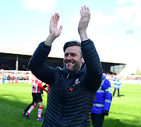 Lincoln City's assistant manager Nicky Cowley applauds the fans at the final whistle<br /> <br /> Photographer Andrew Vaughan/CameraSport<br /> <br /> The EFL Sky Bet League Two - Lincoln City v Cheltenham Town - Saturday 13th April 2019 - Sincil Bank - Lincoln<br /> <br /> World Copyright © 2019 CameraSport. All rights reserved. 43 Linden Ave. Countesthorpe. Leicester. England. LE8 5PG - Tel: +44 (0) 116 277 4147 - admin@camerasport.com - www.camerasport.com