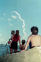 Beachgoers watch the launch of Space Shuttle Columbia, STS-90 mission, Kennedy Space Center, April 1998.  (Photo by Brian Cleary/bcpix.com)