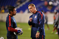United States goalkeeper coach Chris Woods talks with goalkeeper Nick Rimando (12). The men's national team of the United States (USA) was defeated by Ecuador (ECU) 1-0 during an international friendly at Red Bull Arena in Harrison, NJ, on October 11, 2011.