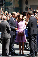 Britain's Prince William, Duke of Cambridge, his wife Kate, the Duchess of Cambridge, and the Mayor of Hamburg Olaf Scholz attend the Elbphilharmonie concert hall on July 21, 2017 in Hamburg, Germany.